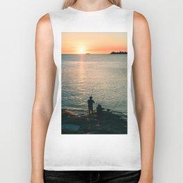 Three fisherman enjoy a beautiful sunset at the shore of 'Colonia del Sacramento, Uruguay'. Biker Tank