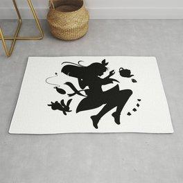 Alice in wonderland falling silhouette (black) Rug