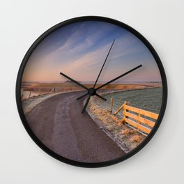 I - Typical Dutch landscape with a dike, in winter at sunrise Wall Clock
