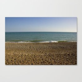 Evening Tide on a cobbled beach Canvas Print