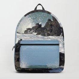 The waves of the Jeju sea crashing on the rocks , Jeju Island, Korea. Backpack