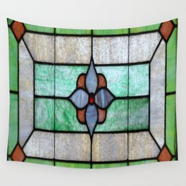Stained Glass features a picture of a classic stained glass window typically found above a door Wall Tapestry