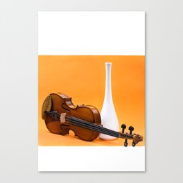 Still life with violin and white vase on an orange Canvas Print