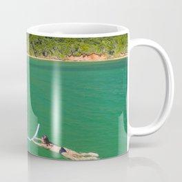 Woman swimming in green waters in Brazil Coffee Mug