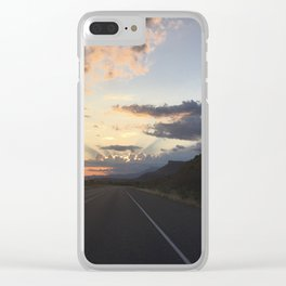 Sunlit clouds over an American road Clear iPhone Case