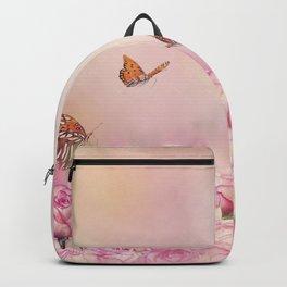 Gulf Fritillary butterflies feed in a rose garden Backpack