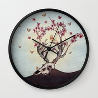 animal skull Wall Clocks featuring Animal Skull and Butterflies by Paula Belle Flores