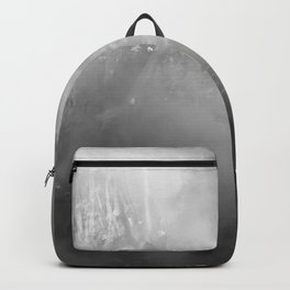 Highlighted Evergreen on a Mountain Backpack