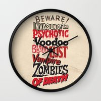 movie posters Wall Clocks featuring B Movie Beware by ochre7