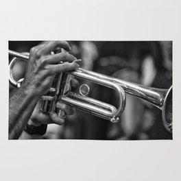 Trumpet player. Rug