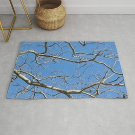 Leafless Tree Branches Against Blue Sky Rug