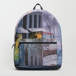 the first snow in Paris Backpack