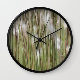 Wispy on green and magenta reeds Wall Clock