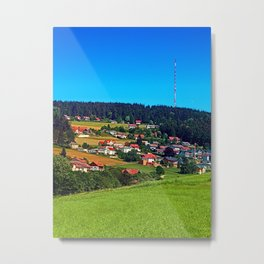 Green grass, the village and a transmitter pole Metal Print