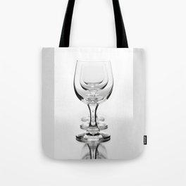 Three empty wine glasses in a row Tote Bag