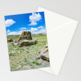 Tarkhatinsky megalithic complex. Steppe and blue mountains on the horizon. Altai Russia. Stationery Cards