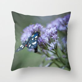 A black butterfly on a wildflower Throw Pillow