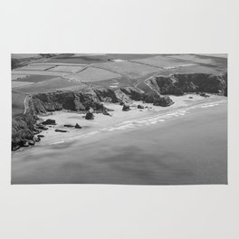 Black and white aerial view of Bedruthan Steps Beach Rug