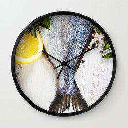 fresh dorado fish and vegetables on wooden board Wall Clock