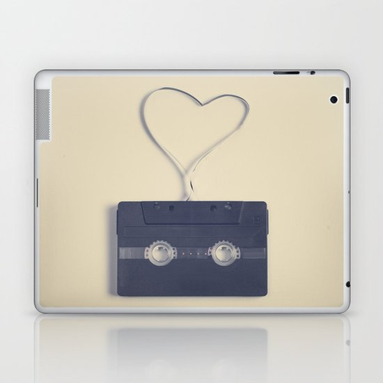 Retro black music cassette and heart shaped tape on beige background Laptop & iPad Skin