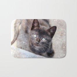 Sweet looking black kitty with big, beautiful eyes. Bath Mat
