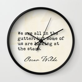 We are all in the gutter, but some of us are looking at the stars. Oscar Wilde Wall Clock