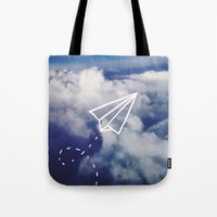 plane Tote Bags featuring Paper Plane by Leah Flores