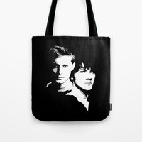 winchester Tote Bags featuring Winchester Brothers by Markusian