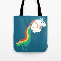unicorn Tote Bags featuring Fat Unicorn on Rainbow Jetpack by Picomodi