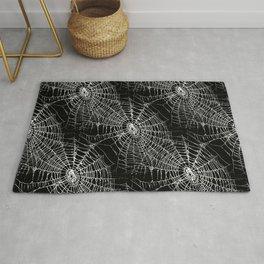 Spiderweb pattern on black Rug