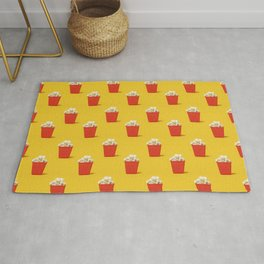 Mini red popcorn box with popcorn pattern on yellow. Rug