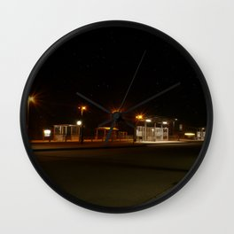 Train and Bus stop in Germany by night Wall Clock
