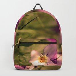 Viola flowers on a meadow Backpack