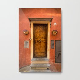 Wooden door of Tuscany with typical bright colors on its walls. Next to two small pots with flowers Metal Print