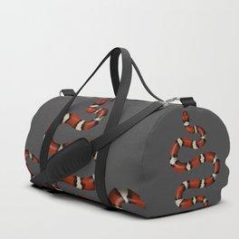 Kundalini red snake slithers on charcoal Duffle Bag