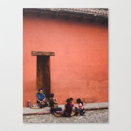 Guatemalan family in traditional dress sells jewellery and cloths on the street in Anitgua Guatemala Canvas Print