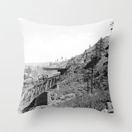 A train of the Southern Pacific Railroad passing over a trestle and into a snow shed in the mountain Throw Pillow