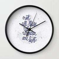 not all those who wander are lost Wall Clocks featuring Not all those who wander are lost by Earthlightened