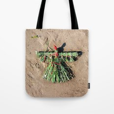 Grass doll in red Tote Bag