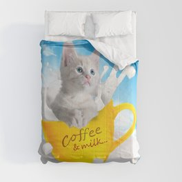 A cat in a coffee and milk cup Comforters