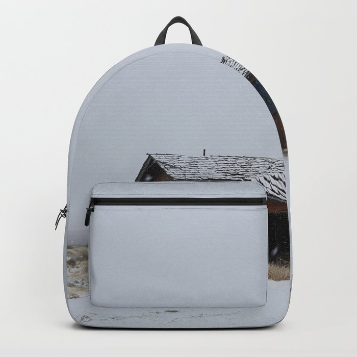 Hopeless, Abandoned, and Alone Under Grey Snow Filled Sky Backpack