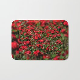 Red roses bunches grow in park Bath Mat