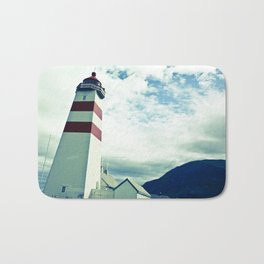Lighthouse in norway Bath Mat
