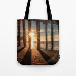Through the Blinds sun bursts through Avila Pier Avila Beach California Tote Bag