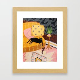 black cat on mustard yellow sofa painting by Tascha Framed Art Print