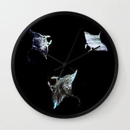 Manta rays in the dark Wall Clock
