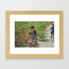 iraqi kids on bicycle Framed Art Print