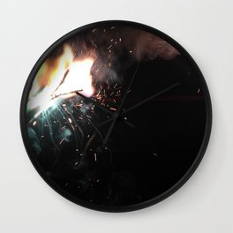 A Light in the Dark Wall Clock
