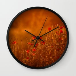 Poppies in golden hour sunlight Wall Clock