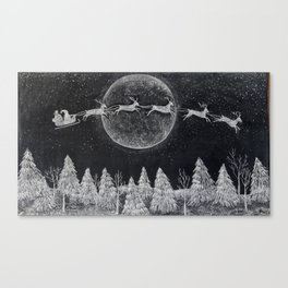 Santa flying over a winter wonderland of snow covered trees in his reindeer drawn sleigh by the light of a full moon Canvas Print